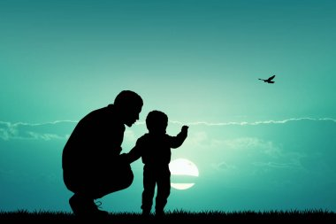 father with child at sunset