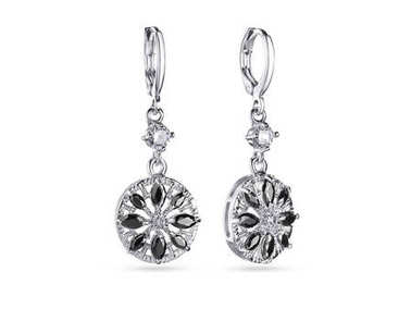 Drop earrings with black crystals on white background, jewelry