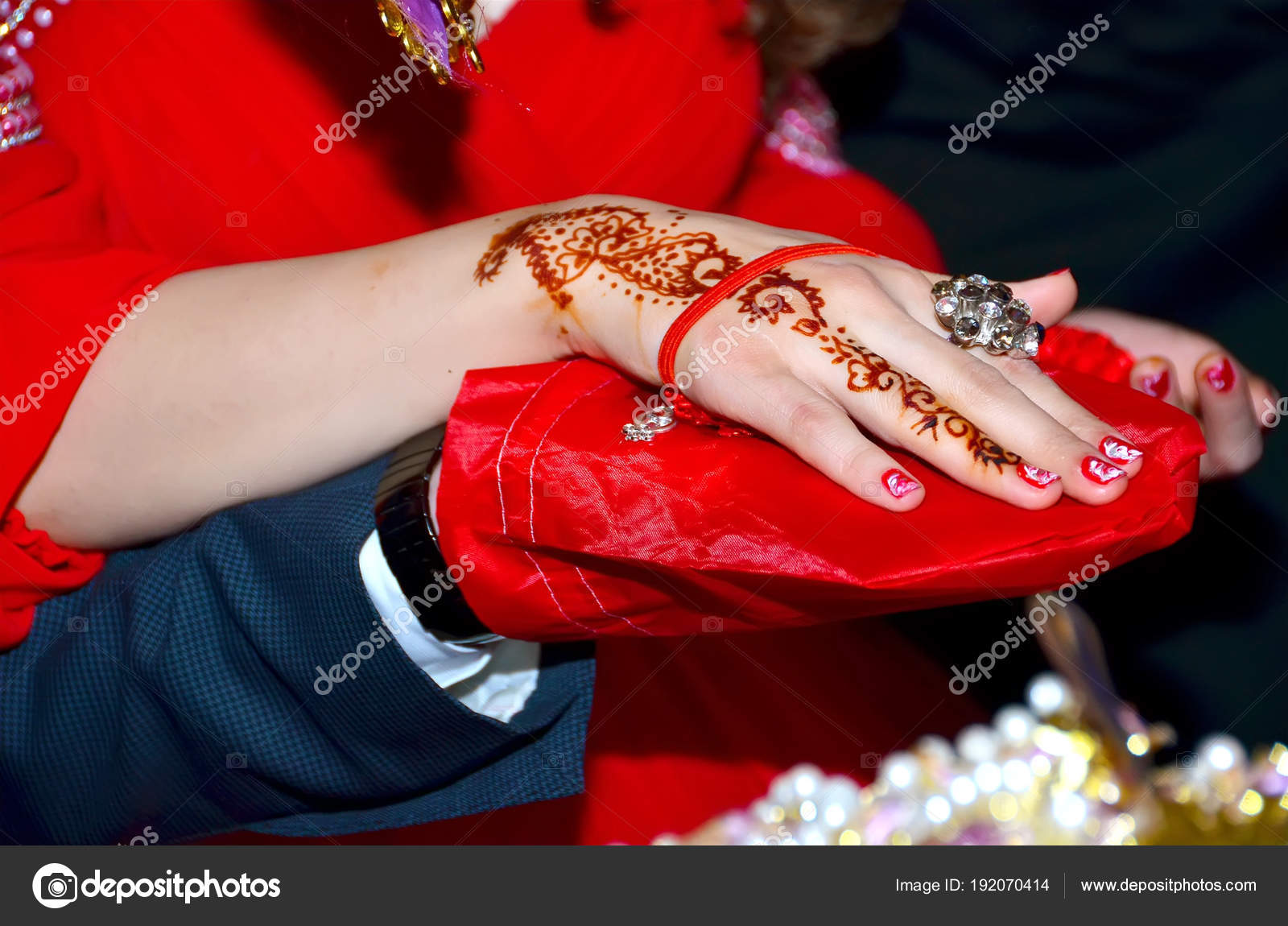 886ed2d62 Hands and fingers are drawn to henna . Female hand with henna tattoo . Soft  selective focus, close up . There are red lacquer and rings on the nail .