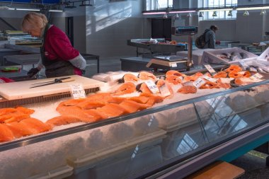 Riga, Latvia - October 28, 2019: Fresh fish at Riga Central Market. Salmon and trout on ice at the fish market in Riga, Latvia.