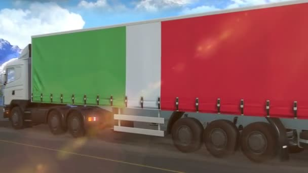 Italy flag shown on the side of a large truck driving on a highway
