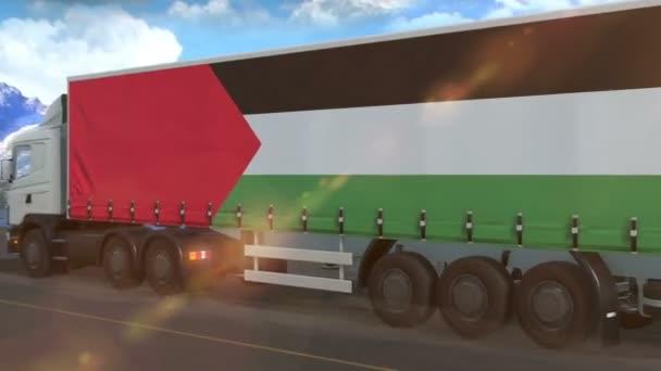 Palestina vlajka je vyvěšena na boku velkého nákladního auta jedoucího po dálnici