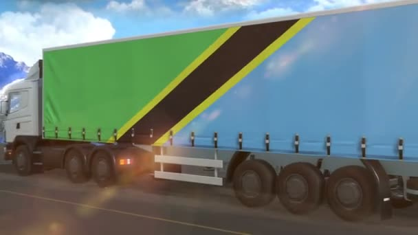 Tanzania flag shown on the side of a large truck driving on a highway