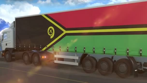 Vanuatu-Flagge auf der Seite eines großen Lastwagens, der auf einer Autobahn fährt