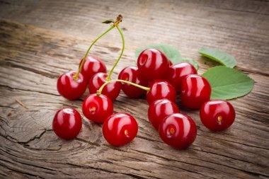 Fresh organic fruit - cherry on wood background selective focus stock vector
