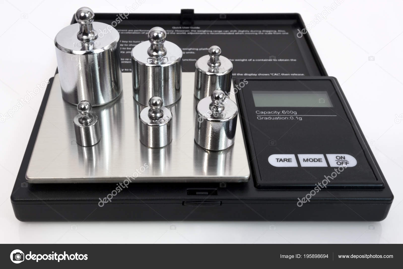 Scale Calibration Weights >> Digital Scale Steel Calibration Weights Isolated Stock Photo
