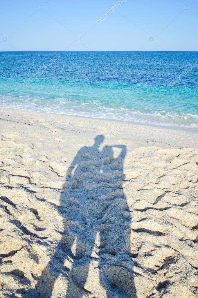 shadow of couple on the beach