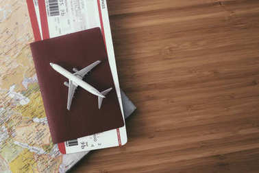 Passport with airplane tickets and map on wooden background, Travel concept