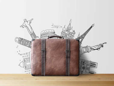 brown valise with sketch of popular tourist attractions on wall, travel concept