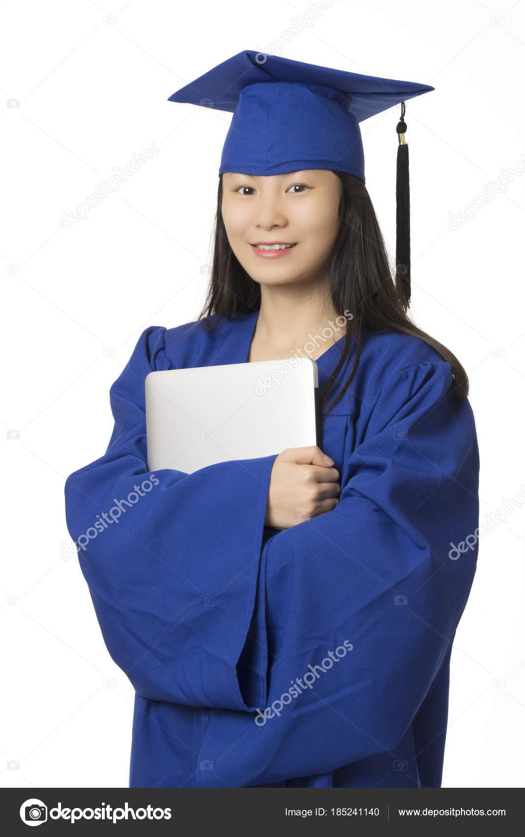 Asian woman holding computer wearing blue graduation gown isolat ...
