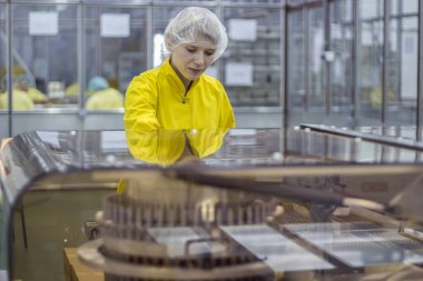 Female Worker At Pharmaceutical Factory