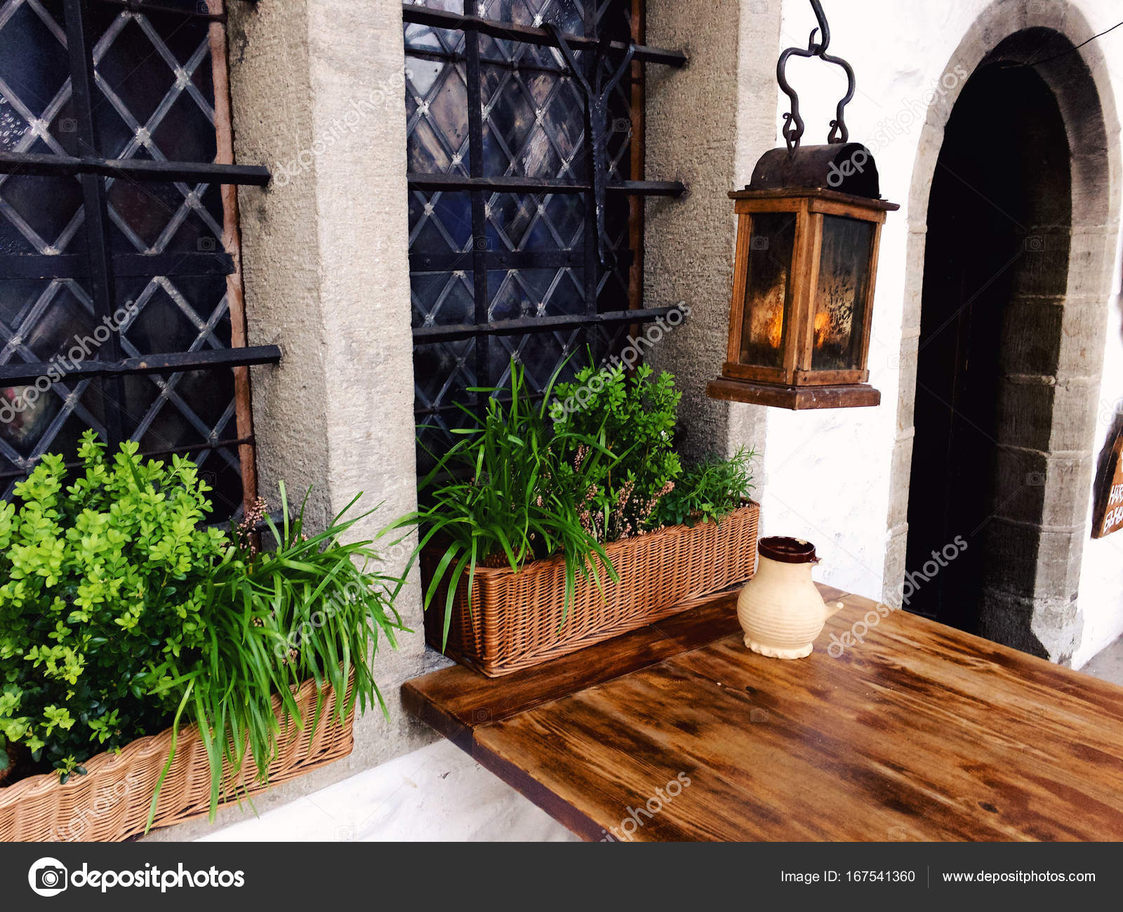 Exterior Of Restaurant With Wooden Table Stock Photo C Legasc 167541360