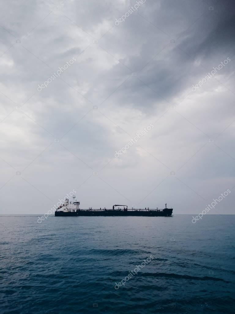 Seascape with a cargo vessel