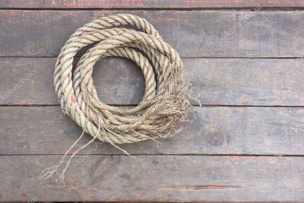 The rope rests on a wooden background.