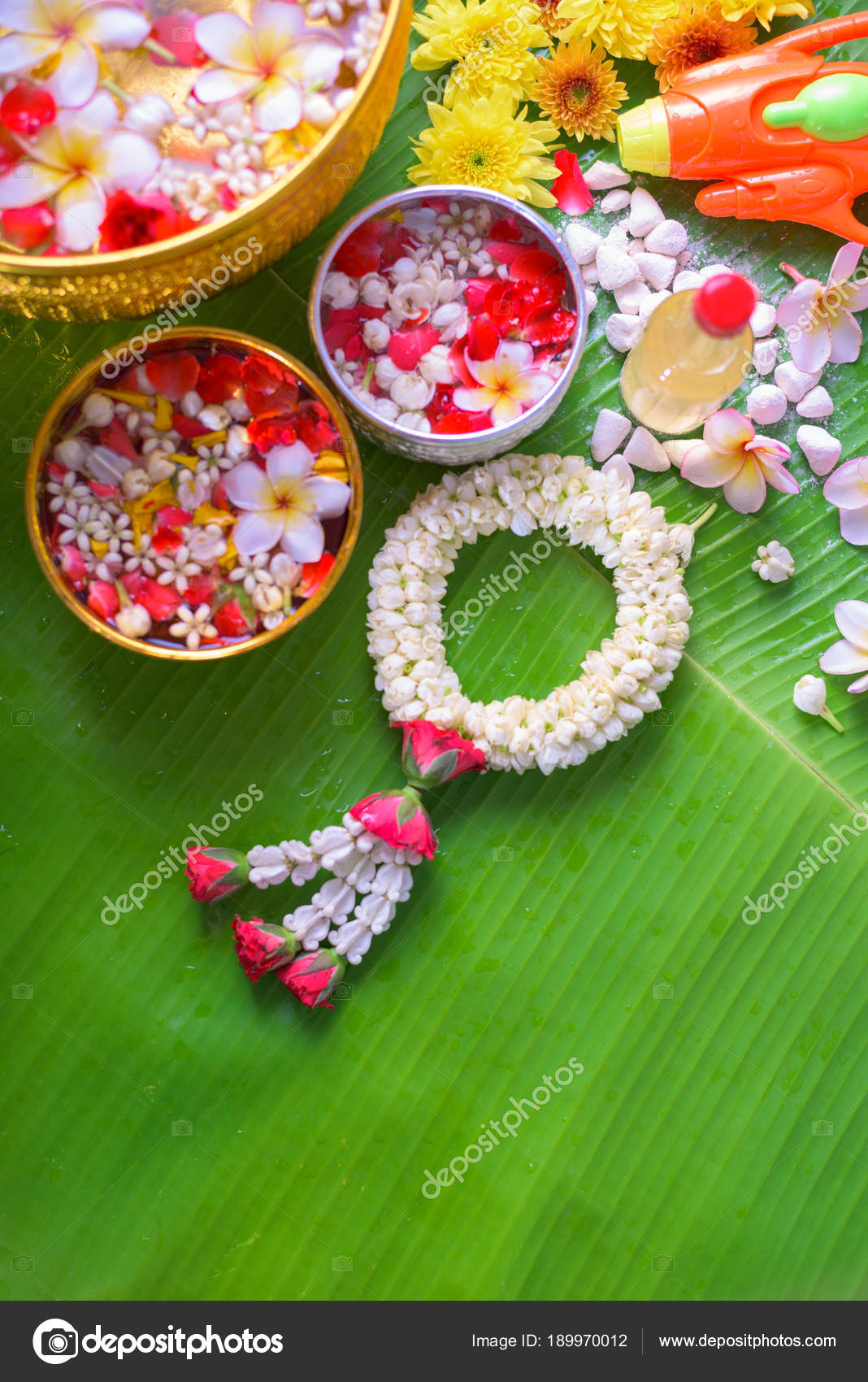 Thai Traditional Jasmine Garland And Colorful Flower In Water Bo