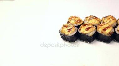 Sushi rolls on a white background.Japanese cuisine sushi rolls of different kinds on a white background isolated