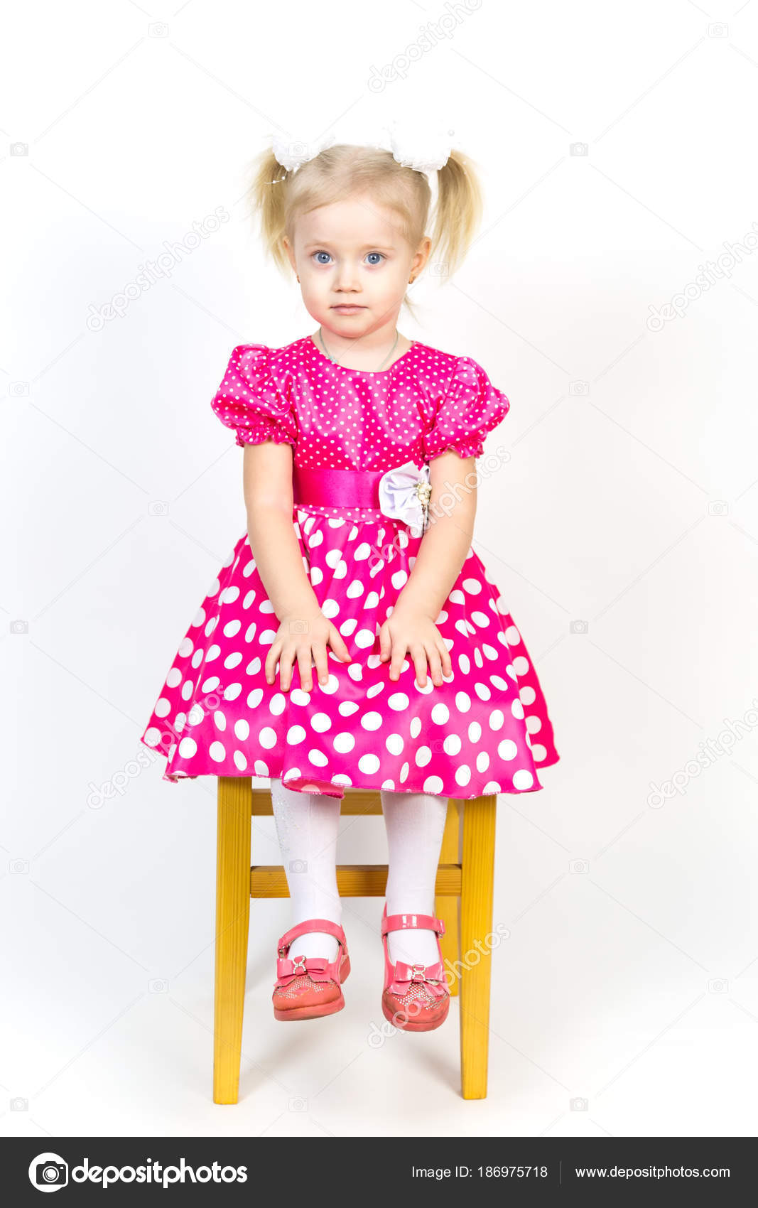 a6f90839de Little girl 3 years old in a red dress with bows in her hair. — · Beautiful  girl in a beautiful fluffy dress posing against a white wall.