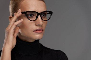Female Eyewear Style. Beautiful Woman In Fashion Eyeglasses