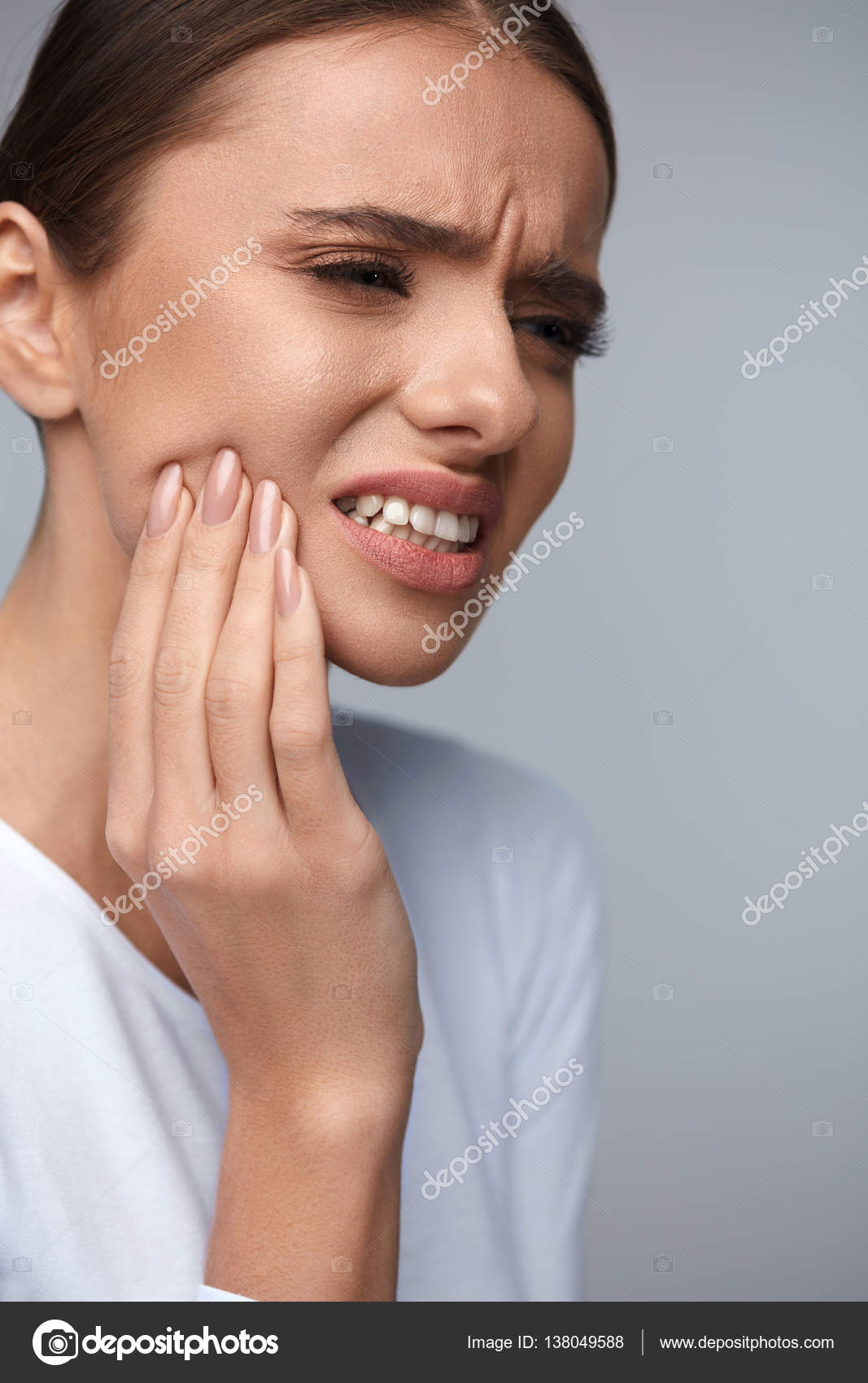 Teeth Pain And Dental Health. Portrait Of Beautiful Woman Suffering From  Annoying Strong Teeth Pain, Touching Her Face With Hand, Feeling Painful  Toothache.
