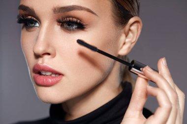 Long Black Eyelashes. Woman With Makeup Applying Cosmetics
