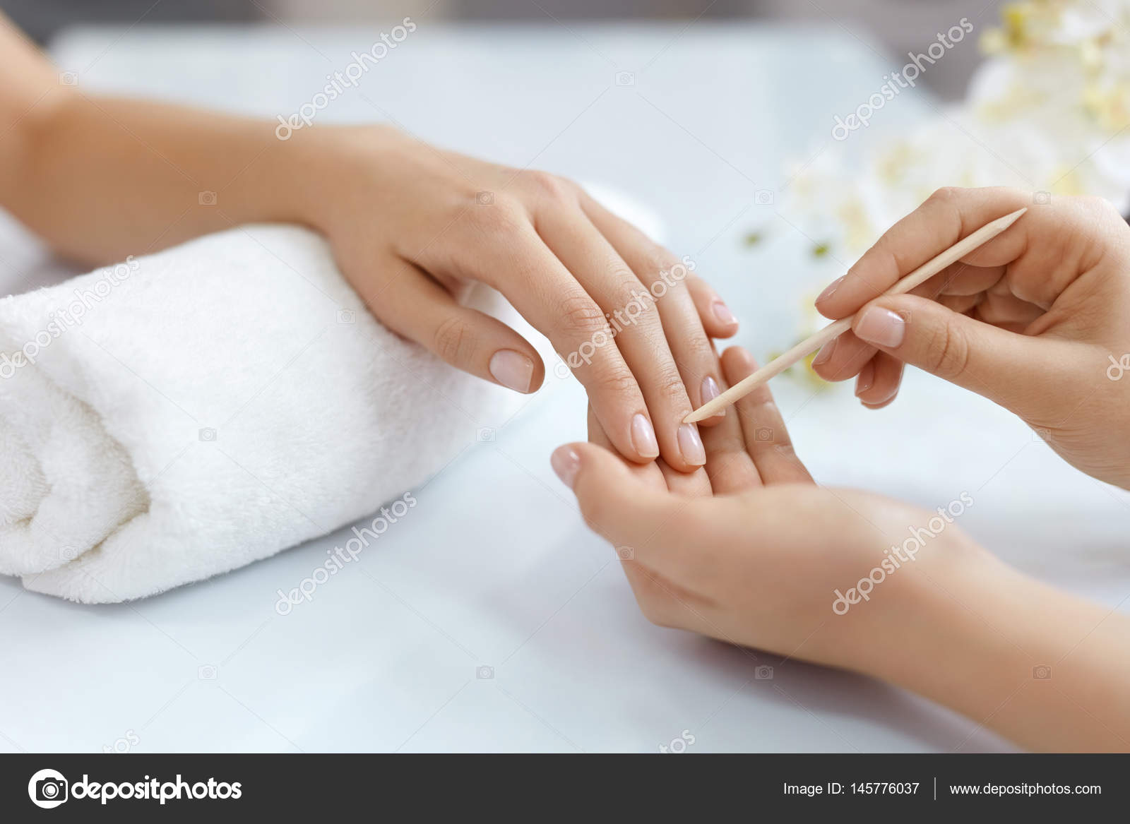 Close-up Hands Pushing Cuticle On Female Nails With Wooden Stick ...