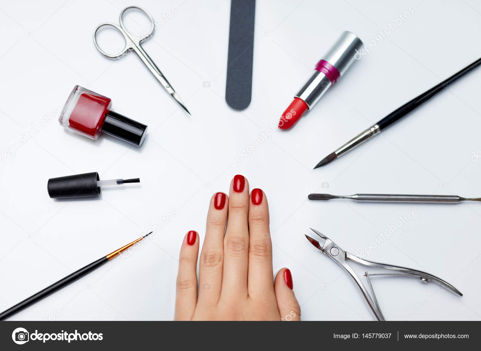 Manicure. Beautiful Woman Hand With Red Nail Polish And Tools ...