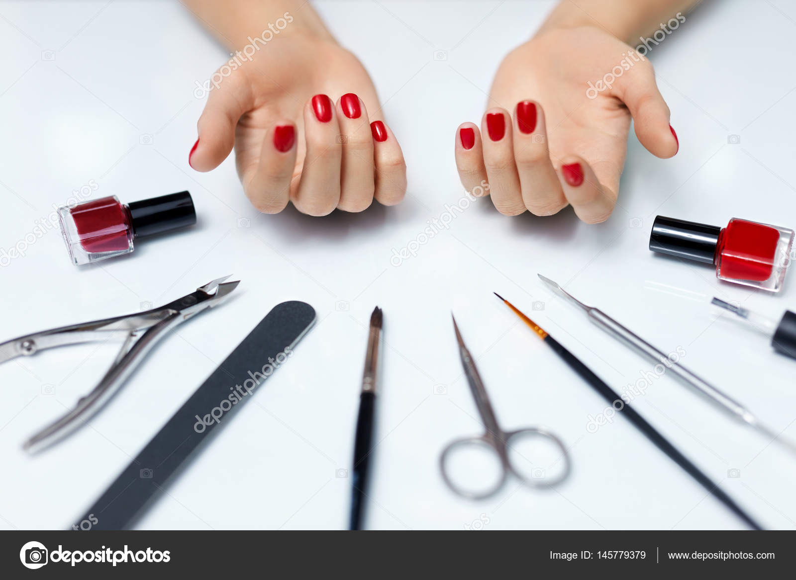 Nail Care. Woman Hands With Red Nail Polish And Manicure Tools ...