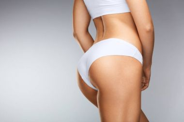 Closeup Beautiful Woman Body In Shape With Firm Butt In Bikini