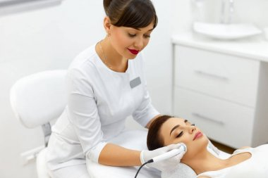 Skin Treatment. Ultrasound Procedure In Cosmetology Spa Center