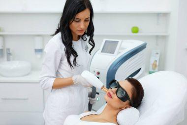 Beautician Using Laser For Skin Rejuvenation In Spa Salon