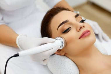 Body Care. Woman Receiving Face Skin Analysis. Cosmetology