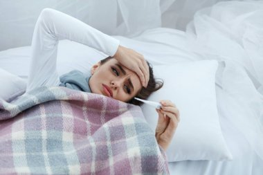 Woman Caught Cold, Having Fever And Measuring Temperature