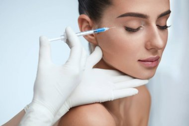 Cosmetic Treatment. Facial Skin Lifting Injection To Woman Face