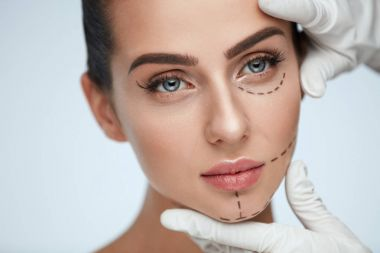 Young Female With Surgical Lines, Smooth Skin And Perfect Makeup