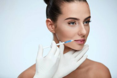Plastic Surgery. Beautiful Woman Face Getting Beauty Injections