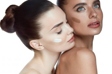 Face Cosmetics. Sexy Models With Foundation On Skin