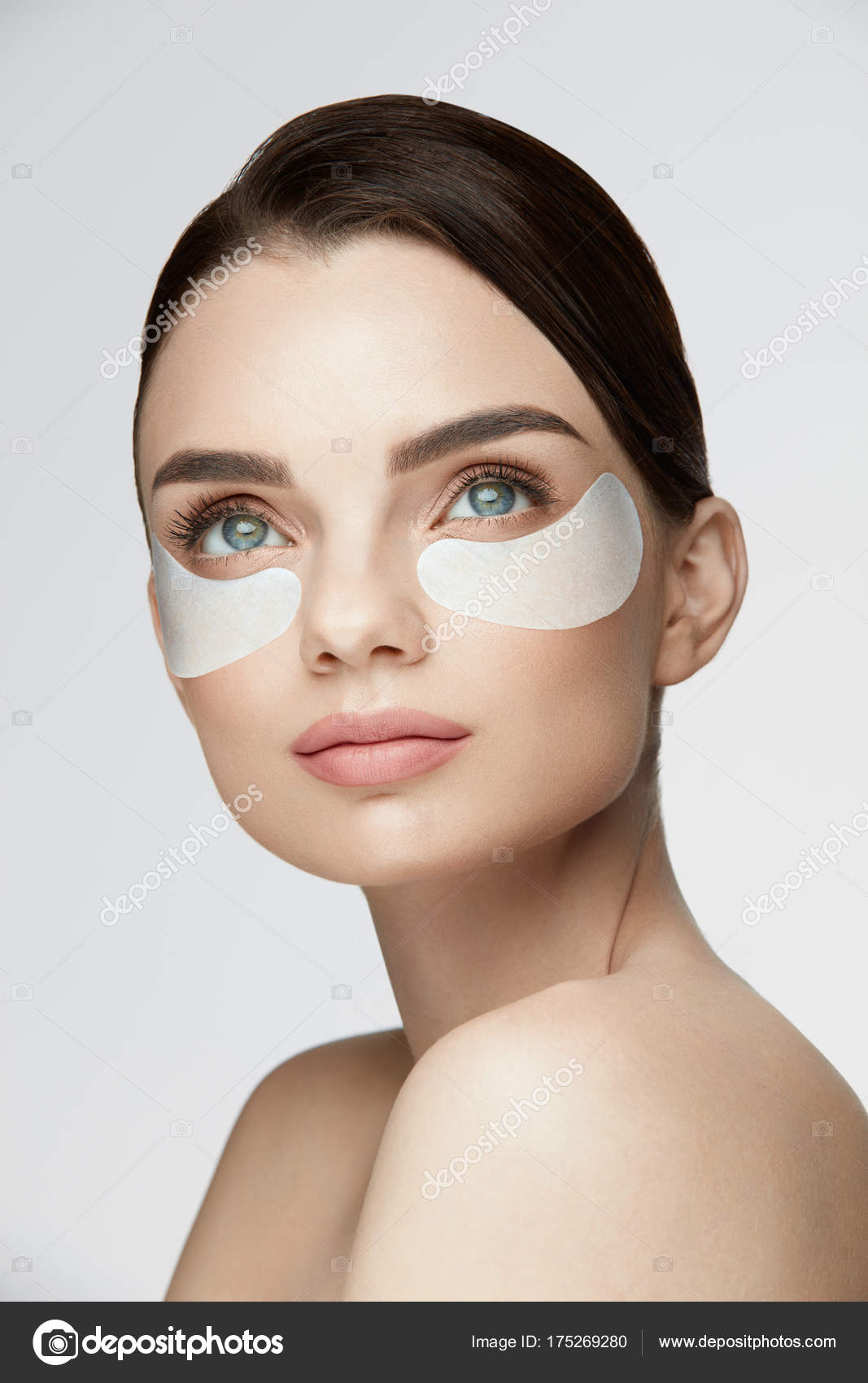 Face Skin Care Female With Mask Under Eyes Patches On Skin Stock