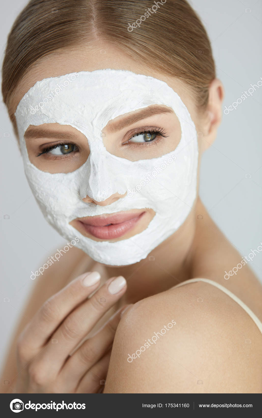 Skin Care Mask Close Up Of Woman With White Face Mask Stock Photo C Puhhha 175341160