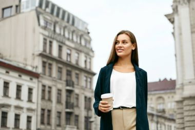 Beautiful Business Woman With Drink On Go Walking On Street.