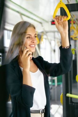 Beautiful Woman Talking On Phone While Going To Work In Bus.