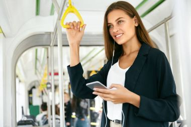 Young Beautiful Woman Listening Music On Phone In Bus.