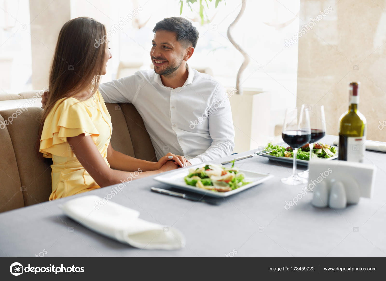 Romantic Couple Having Dinner For Two In Restaurant Stock Photo C Puhhha 178459722