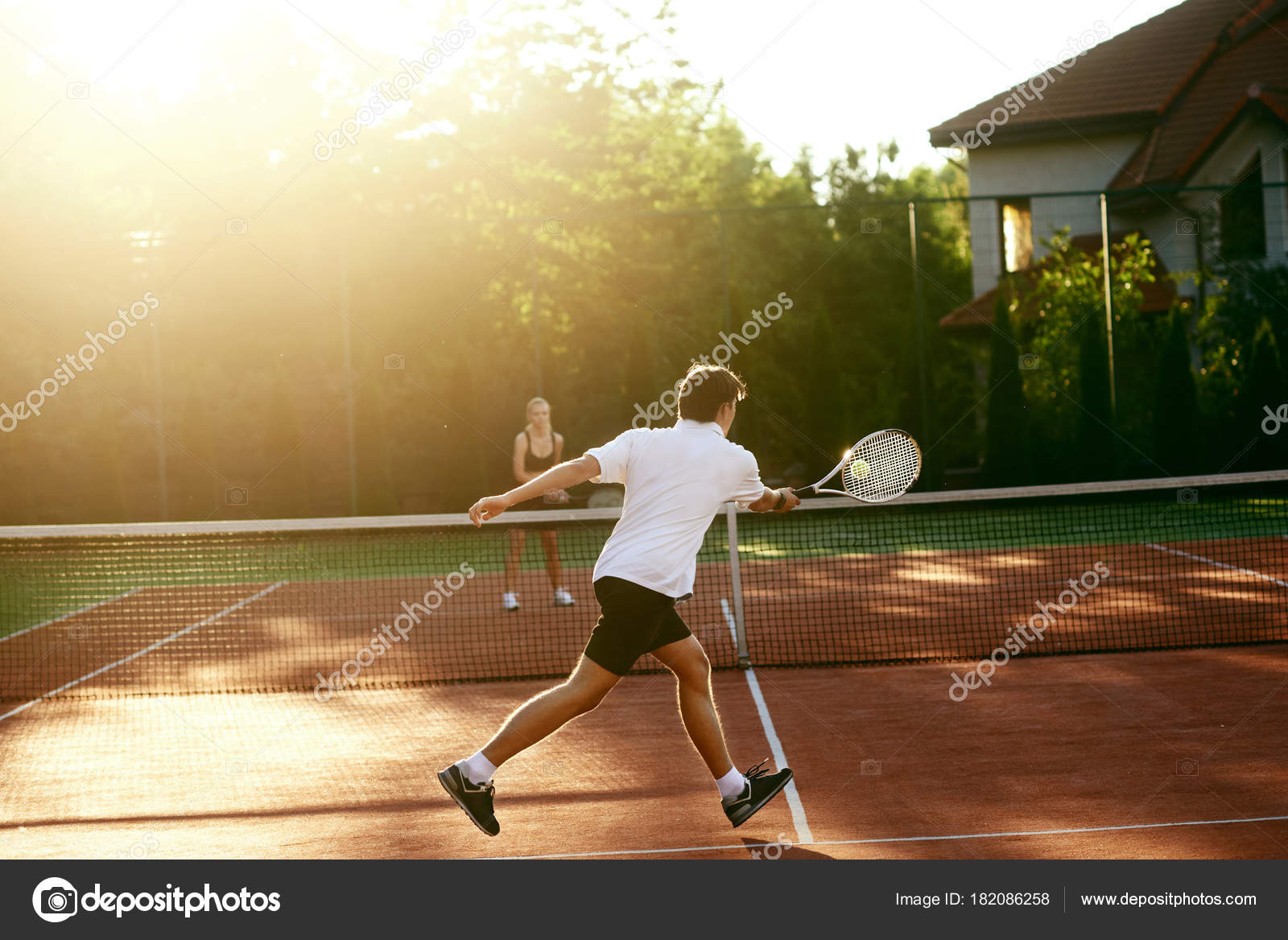 Young People Playing Tennis Outdoors Stock Photo C Puhhha 182086258