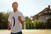 Man Playing Tennis Outdoors.