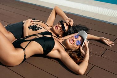 Fashion Women In Swimsuits Relaxing In Summer.