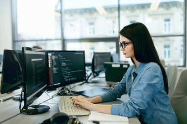 Young Woman Working And Programming On Computer In Office.