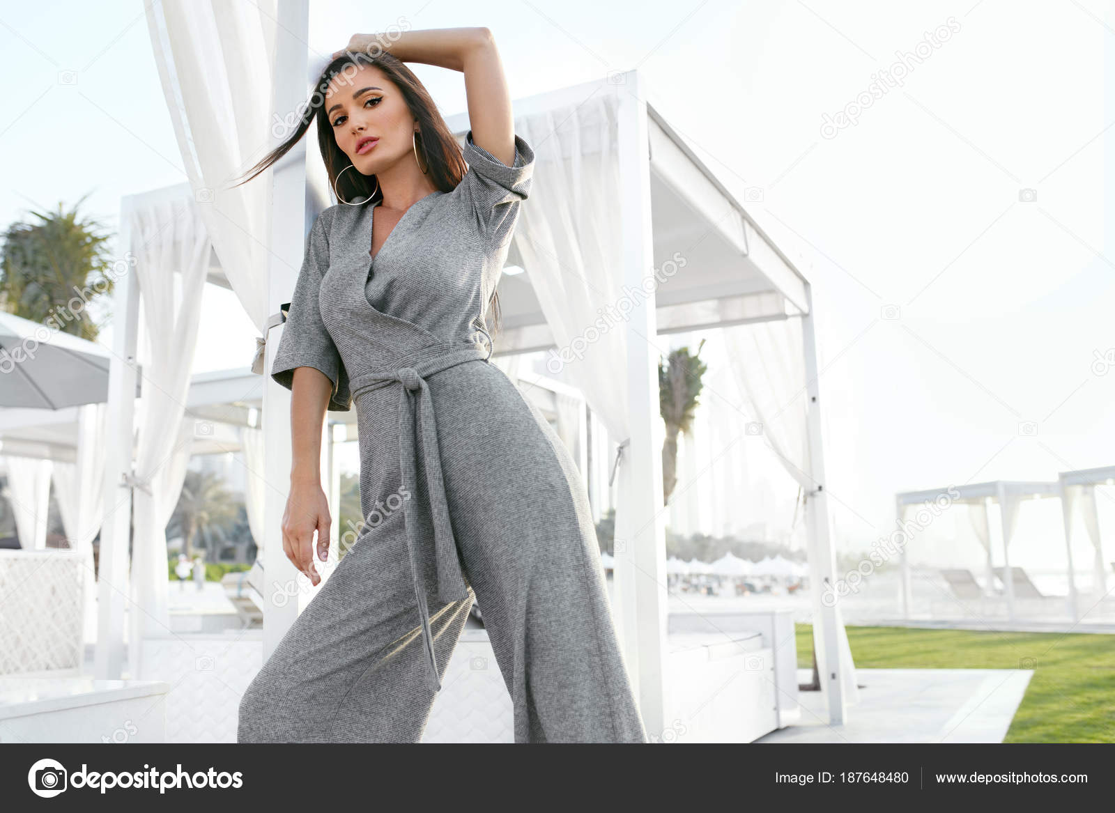 da3702b53ff8 Women Fashion. Woman In Fashionable Clothes. Portrait Of Gorgeous Sexy  Female Model In Stylish Jumpsuit Relaxing Outdoors At Luxury Resort.
