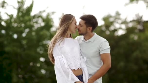 Beautiful Couple In Love Embracing In Nature. Portrait Of Happy Woman And Handsome Young Man In Hugging And Enjoying Summer On Weekend. People On Romantic Date Outdoors