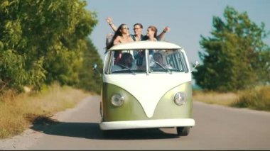Summer Travel. Happy Friends Going On Trip, Having Fun. Smiling Young Men And Beautiful Women Traveling In Retro Bus, Enjoying Summertime On Vacation. Friendship Concept.
