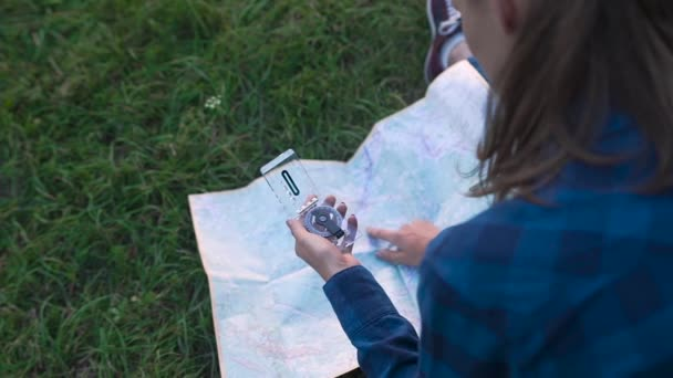 Woman Traveling, Using Map And Compass, Searching For Road Using Travel Equipment In Nature.